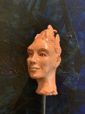 modelage humain visage terre patine sculpture