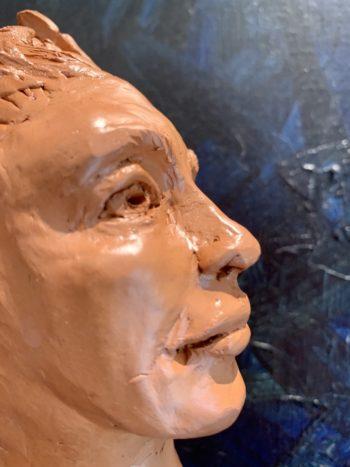 tête de femme homme feuilles sculpture
