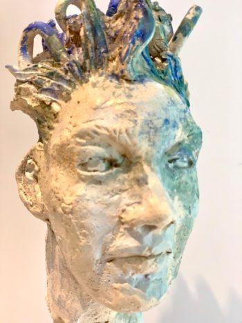 tête sculptée homme céramique effets matière